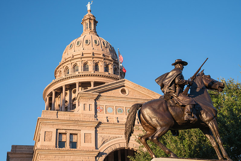 Texas State Capitol with Texas Rangers Monument